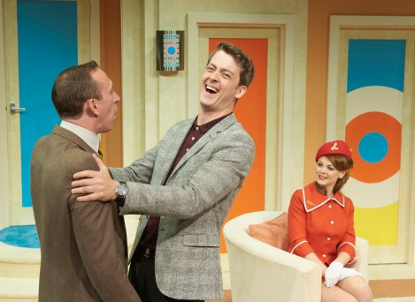 Playboy Bernard (Max Gell) introduces best pal Robert (Steven Blakeley) to fiance number one Gloria (Rebecca Witherington). Photo by Geraint Lewis.